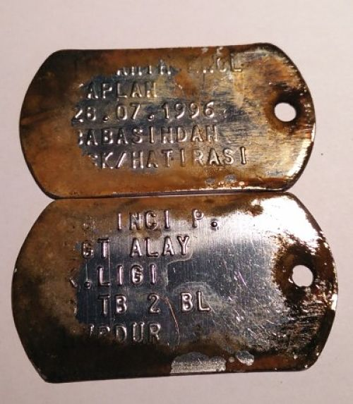 Close-up of dog tags caught during magnet fishing